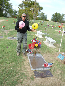 Bobby Fox holding Rally Flags at the grave of Jared Sheomaker